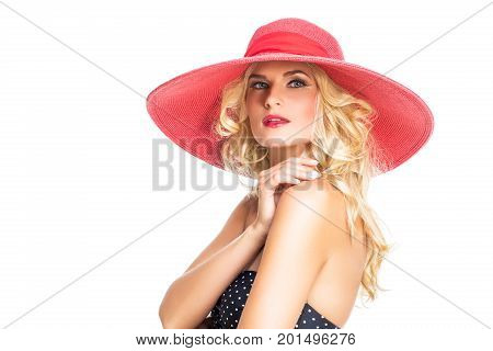 beautiful young woman in polka dots retro bikini and red summer hat. studio shot isoalted on white background. copy space.