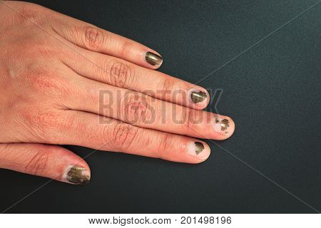 Glitter dark color Nails polish scratched on black background with copy space