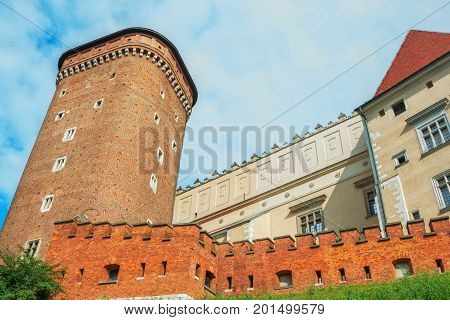 Krakow/Poland- August 14, 2017: Wawel Royal Castle, view of Senator Tower and  defensive fortification. Medieval residence of kings.