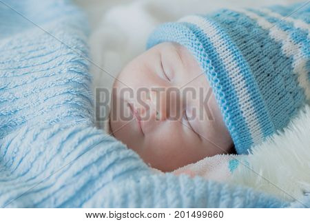 Newborn Baby Girl Is Sleeping With A Knitted Hat Baby