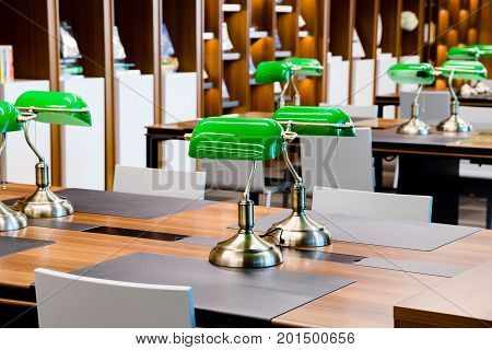 Green Lamps on table in a school's library
