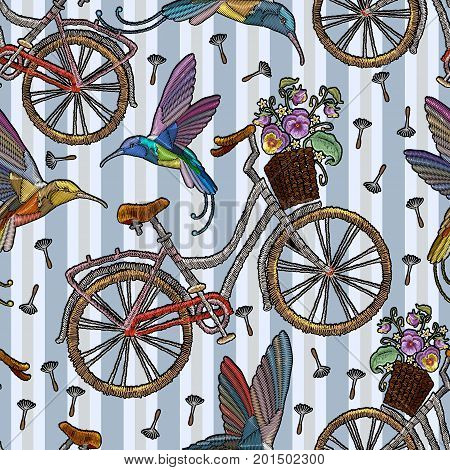Embroidery bicycle with basket humming-bird and summer flowers seamless pattern. Fashionable embroidery bicycle humming bird and spring flowers romantic art template for clothes t-shirt design