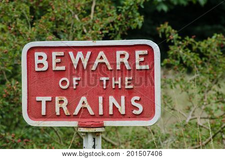 Old fashioned cast iron Beware of Trains sign