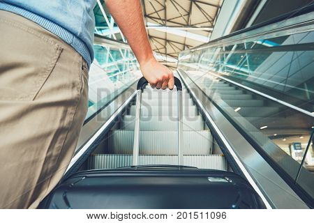 Man Traveling By Airplane