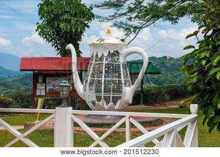 Huge White Metal Kettle. Colorful Padlocks Heart Shaped On Blurred Background, Symbol Of Love. Sabah