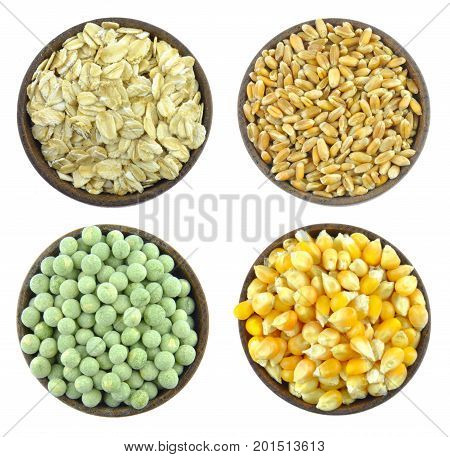 Wheat, corn, oat flakes, green peas isolated on white background