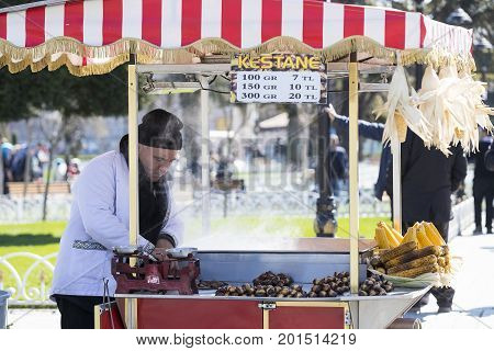 ISTANBUL, TURKEY - 1 APRIL , 2017:Sellers of fried corn chestnuts in the streets of Istanbul in Turkey