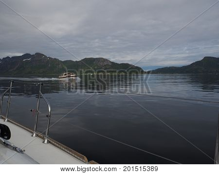 TROLL FJORD, NORWAY-JULY 10, 2017. View of the fjord of the Troll in Norway. Sailing yacht. Norwegian fjord. Natural landscape. Location: Lofoten Islands, Norway. White nights morning summer travel.