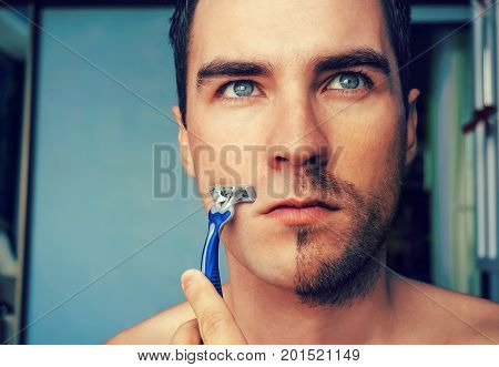 Man Shaves In The Morning With A Straight Razor
