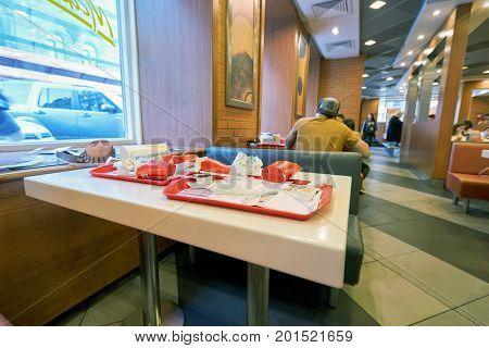 SAINT PETERSBURG, RUSSIA - CIRCA AUGUST, 2017: left food tray at McDonald's restaurant. McDonald's is an American hamburger and fast food restaurant chain