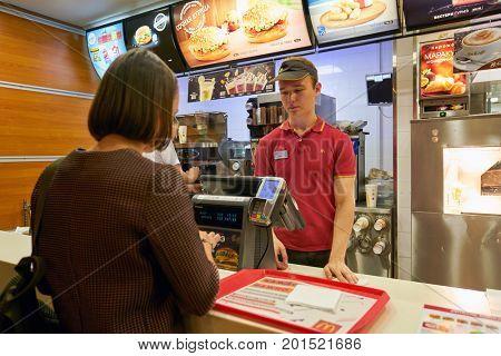 SAINT PETERSBURG, RUSSIA - CIRCA AUGUST, 2017: inside McDonald's restaurant. McDonald's is an American hamburger and fast food restaurant chain
