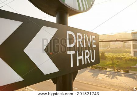 BUSAN, SOUTH KOREA - CIRCA MAY, 2017: drive-thru sign at Starbucks coffee shop in Busan. Starbucks Corporation is an American coffee company and coffeehouse chain.