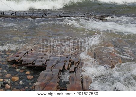 Waves on a beach with shipwreck, Pictured Rocks National Lakeshore, Upper Peninsula of Michigan