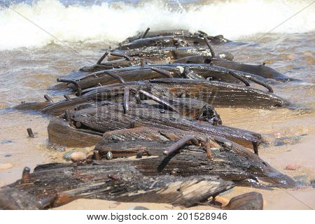 Wooden shipwreck on the sandy beach of Pictured Rocks National Lakeshore, Upper Peninsula of Michigan