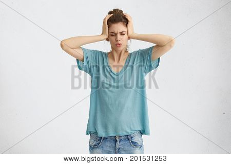 Negative Emotions, Stress Headache And Frustration. Stressed Frustrated Young Caucasian Female Dress