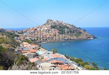 Charming little medieval town Castelsardo in Sardinia. A small Medieval historical town in northern Sardinia with its unparalleled ancient architecture, castles and churches, which rises on top of a hill surrounded by a beautiful sea.