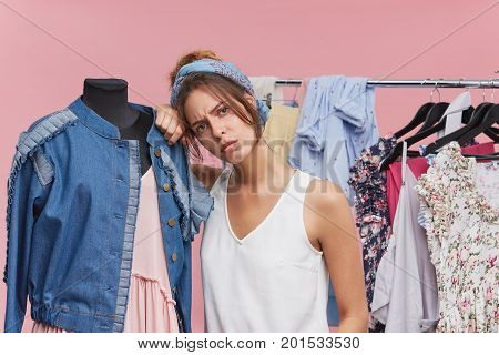 Beautiful Exhausted Woman Standing Near Mannequin, Having Tired And Sad Expression After Spending Al
