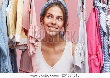 Lovely Smiling Female Looking Aside With Cheerful Expression, Having Good Mood After Successful Shop