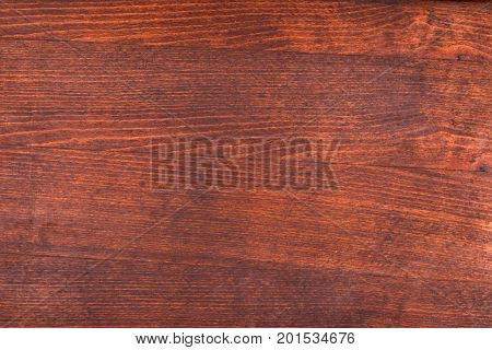 Dark wooden surface made of veneer. View from above.