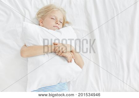 Small Adorable Girl With Blonde Hair, Freckled Face, Closing Her Eyes, Hugging White Pillow, Sleepin