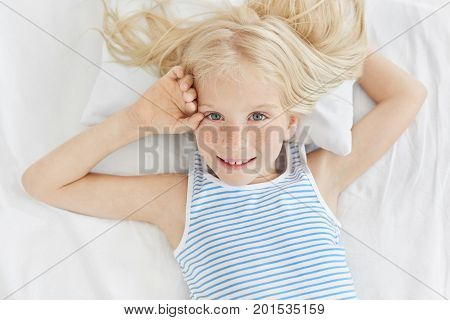 Freckled Blue Eyed Girl With Blonde Hair, Wearing Striped T-shirt, Looking With Delightful Expressio