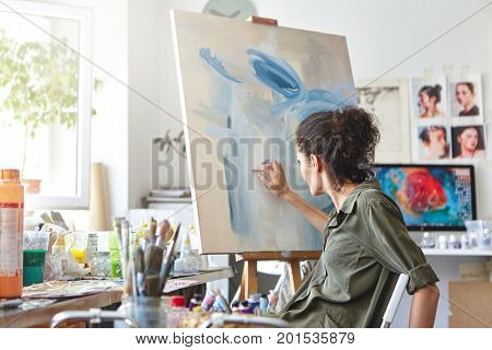 Art, Creativity, Hobby, Job And Creative Occupation Concept. Rear View Of Busy Female Artist Sitting