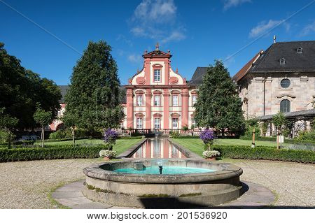 Baroque Domdechanei reflecting in a pond Fulda Hessen Germany