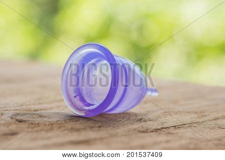 Feminine Hygiene Product - Menstrual Cup On A Wooden Background