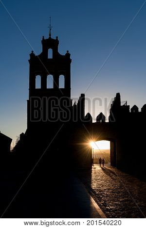 Sunset in the city of Avila with a couple backlit