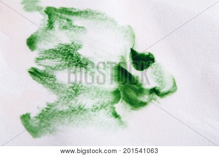 Abstract watercolor background. Expressive brush strokes of green aquarelle on paper texture. Modern art backdrop with copy space
