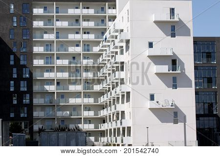 Modern minimalistic Urban Apartment Building with white facade