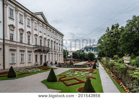 Salzburg Austria - August 6 2017: Scenic view of Mirabell Gardens in Salzburg a rainy day of summer. The Old Town of Salzburg is internationally renowned for its baroque architecture and was listed as a UNESCO World Heritage Site.