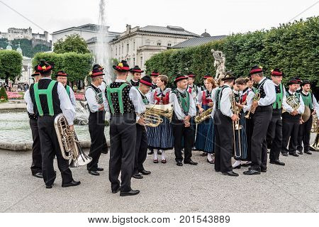 Salzburg Austria - August 6 2017: Traditional music band in Mirabell Gardens in Salzburg. The Old Town of Salzburg is internationally renowned for its baroque architecture and was listed as a UNESCO World Heritage Site.
