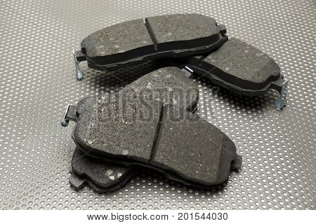 Front and rear wheel disc brake pads on worktable