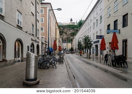 Salzburg Austria - August 6 2017: Scenic cityscape of Salzburg a rainy day of summer. The Old Town of Salzburg is internationally renowned for its baroque architecture and was listed as a UNESCO World Heritage Site.