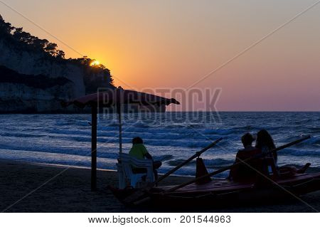 Family watching sunset on a lifeguard boat. for vacation and summer holiday concept