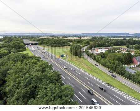 Aerial view of a highway intersection with a clover-leaf interchange in Germany Koblenz