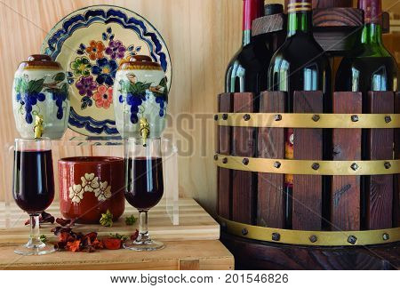 Winery environment. Environment created with glasses and container of wine bottles.