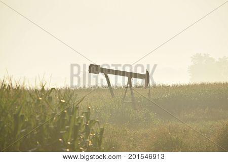 a foggy hazy morning around a oil pump.