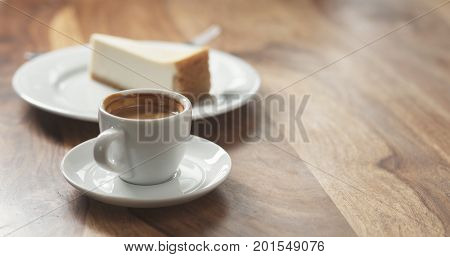 espresso and cheesecake on table, wide photo