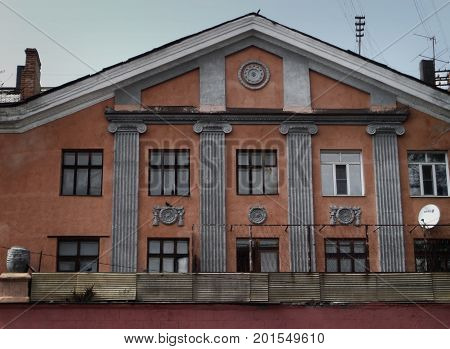 Kazakhstan, Ust-Kamenogorsk - 01, August 2017. A fragment of a house on Gogol street. Architecture. Architectural background. Antique architecture.