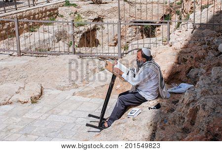 HEBRON ISRAEL - APRIL 12 2009: Orthodox jewish man pray next to Tomb of the Patriarchs (Ma'arat HaMachpela) in Hebron