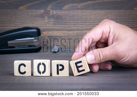 Cope from wooden letters on wooden background.