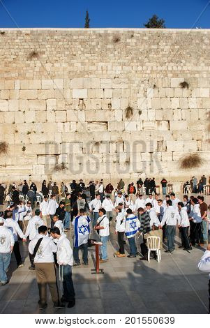 JERUSALEM ISRAEL - MARCH 19 2009: Young jewish teenagers dancing at the Wailing Wall in the Old City of Jerusalem