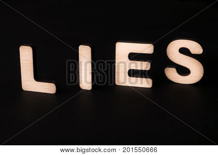 Word Lies on black background. Untruth, taradiddle, fake concept