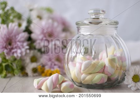 A jar with sweets. Marshmallow.  A gentle still-life with sweets.