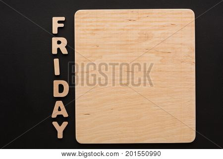Word Friday with blank wooden board. Timetable, day of week, to-do-list, time management concept