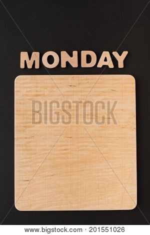 Word Monday with blank wooden board. Timetable, day of week, to-do-list, time management concept