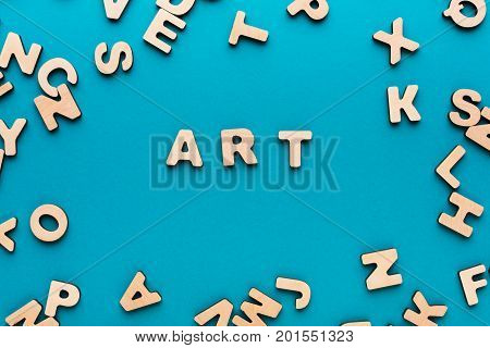 Word Art on blue background, in wooden letters frame. Creativity, craftsmanship, modern life concept