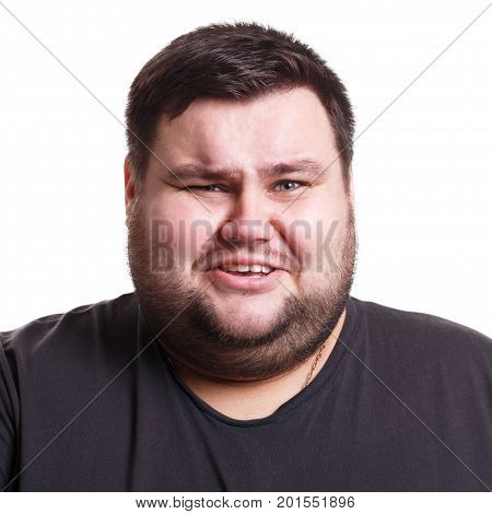 Feeling disgust. Fat man with unpleasant expression on face, negative emotion, white isolated studio background